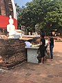Worship Buddha and give flowers to load.jpg