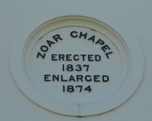 Zoar Strict Baptist Chapel - A recessed roundel in the pediment shows the dates of construction and enlargement.