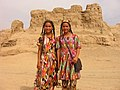 Тraditionally dressed Uyghur girls at Astana Ancient Tombs, Turpan, Xinjiang.jpg