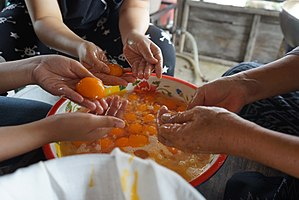 Separating eggs - Separating eggs by hand for making Thai sweets