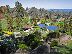 This view from the Symbolic Mountain Lookout in Cowra, NSW shows many of the typical elements of a Japanese garden