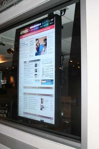 NBCNews.com - A flat screen monitor on a wall in 30 Rock, showing msnbc.com