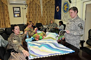 Afghan (blanket) - Afghans being made for charity by US military members at a crochet club.