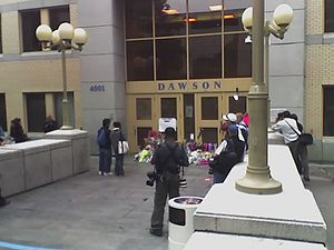 Dawson College shooting - Two days after the event, people bring flowers to the de Maisonneuve entrance, where the first shots had been fired.