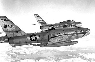 164th Airlift Squadron - Two F-84F Thunderstreaks in formationm 51-9433 and 52-6938