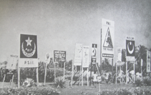 Indonesian legislative election, 1955 - Campaign posters with the symbols of the parties on display in the run up the election