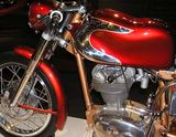 "The front half of pristine 1960s Italian single-cylinder motorcycle with polished chrome accents on the so-called ""jellymould"" style gas tank."
