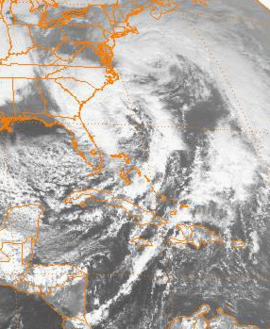 A satellite image of the eastern United States and western Caribbean Sea, depicting two large storms.