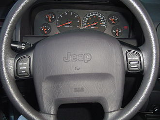 Cruise control - Cruise control mounted on a 2000 Jeep Grand Cherokee steering wheel