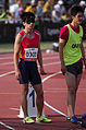 2013 IPC Athletics World Championships - 26072013 - Lei Xue and guide Lin Wan of China preparing for the Men's 100m - T11.jpg