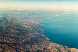 Rif - Moroccan Mediterranean coast - aerial view west from Bades over El Jebha to Tétouan with Rif mountains, Tanger-Tetouan-Al Hoceima (2014)