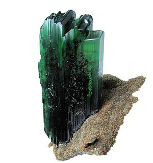 Vivianite - Vivianite tabular crystal, transparent, with a deep green color. Crystal size: 82 mm x 38 mm x 11 mm. From Huanuni mine, Dalence Province, Oruro Department, Bolivia