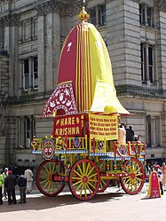 A Jagannath ratha with the abstract circular icon for Krishna at Chamberlain Square UK.jpg