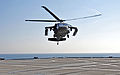 A U.S. Army UH-60 Black Hawk helicopter with the 12th Combat Aviation Brigade prepares to land on the flight deck of the amphibious command ship USS Mount Whitney (LCC 20) June 12, 2013, in the Baltic Sea during 130612-N-PE825-015.jpg