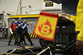 A U.S. Navy firefighting team with the air department participate in a hangar bay fire drill aboard the amphibious assault ship USS Bataan (LHD 5) in the Atlantic Ocean Dec. 12, 2013 131212-N-RB564-017.jpg