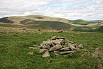 A cairn on Arkland Craig At the 347m spot height shown on the O.S. Landranger map. The prominent hill in the distance centre left is Cairnkinna Hill.
