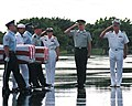 A multi-service honor guard carries caskets containing the remains of 24 service members recovered from the Vietnam and Korea War during a repatriation ceremony on Hickam Air Force Base, Hawaii 011005-N-JW822-002.jpg
