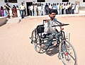 A physically handicapped person coming out from the polling booth after casting his vote in Sanand, Ahmedabad constituency, in Gujarat, during the third phase of General Election-2009 on April, 30, 2009.jpg
