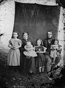 A woman, man and four children NLW3364937.jpg