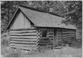 Abandoned log house. Border of Newton and McDonald counties - NARA - 283767.tif