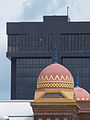 Abou Ben Adhem Shrine Mosque roof, against a modern building (old vs new).jpg