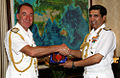 Adm. Robin K. Dhowan and Royal Navy Adm. George Zambellas exchanging mementos after holding discussions.JPG