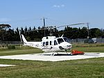 Aeropower Bell 212 Eagle Single at Latrobe Regional Airport equipped with helicopter bucket.jpg