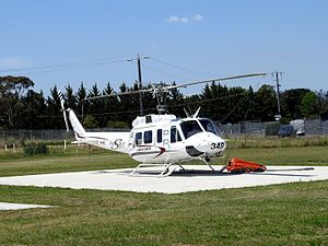 Latrobe Regional Airport - Image: Aeropower Bell 212 Eagle Single at Latrobe Regional Airport equipped with helicopter bucket