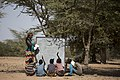 African teacher teaching under a tree.jpg