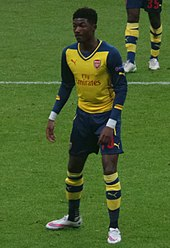 A colour photograph of Ainsley Maitland-Niles, in action for Arsenal.