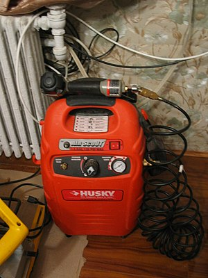 Air compressor - Air compressor supplies air into a nail gun