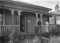 Albert Percy Godber and Laura Godber outside their house at 23 Bay Street, Petone ATLIB 141470.png