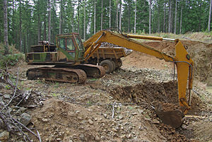 Borrow pit - An excavator working in a borrow pit.