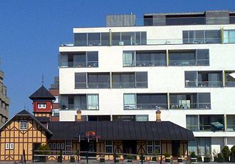 Amerika Plads - The former Free Port Station and a modern Nordlyset, a modern residential building designed by C. F. Møller Architects