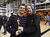 Andrew Stanton and Victor Navone holding the Academy Award for Best Animated Feature