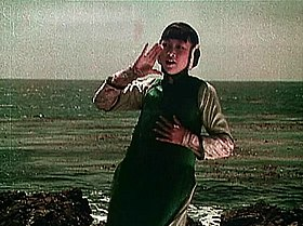 Anna May Wong as Lotus Flower calling out in The Toll of the Sea.jpg