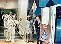 Apollo 8 crew walks to transfer van (S68-55999).jpg
