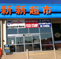 Arlington TX multilingual supermarket signs.png