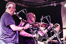 Attila the Stockbroker (centre, playing violin) performing with Barnstormer 1649 at Calstock Hall. September 2018.