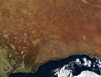 Nullarbor Plain - NASA – Visible Earth, Nullarbor. The true Nullarbor is the light tan semi-circular area adjacent to the coast. Image acquired by the Terra on 19 August 2002
