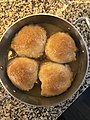 Baked apple dumplings in a pan.jpg