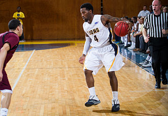 Texas A&M–Commerce Lions - The TAMUC men's basketball team in action against West Texas A&M in 2014