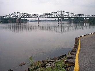 Parkersburg Bridge (CSX) - The Parkersburg-Belpre Bridge (foreground), the CSX Bridge (middle ground), and the Memorial Bridge (background), crossing the Ohio River, as viewed from Point Park in Parkersburg, West Virginia.
