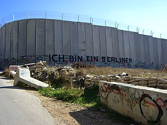 "Israeli West Bank barrier - Graffiti on the road to Bethlehem in the West Bank stating ""Ich bin ein Berliner"""