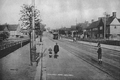 Black and white photograph of a tram travelling on Well Road.png