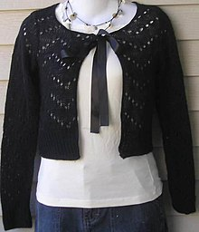Black open-front cropped knit cardigan with a ribbon tie at the neck