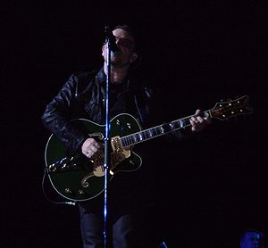 Gretsch - Bono playing a Gretsch Irish Falcon.
