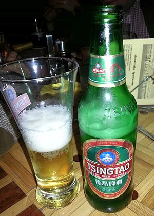 Tsingtao Brewery - Bottle and glass of Tsingtao beer