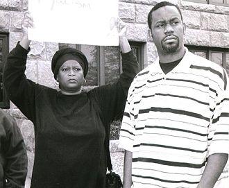 Brenda Cherry - Brenda Cherry with Paris resident Patrick Lyons protesting in 2010