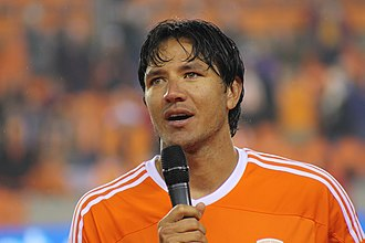 Brian Ching - Brian Ching speaks to the crowd at BBVA Compass Stadium in Houston on December 13, 2013 after his testimonial match.
